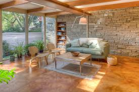 stained concrete floors family room midcentury with eames plywood