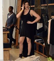 khloe kardashian is sultry in a revealing dress and red lipstick