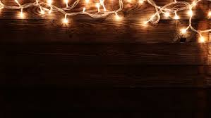 light bulbs on wood background with star filter copy space