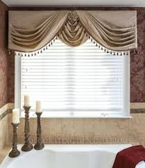 valance swag treatment featuring ornate medallions to complement