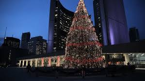 evening at toronto city hall with the christmas tree light up and