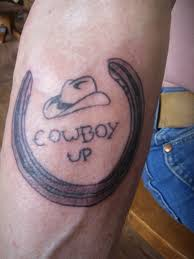 cowboy hat with horseshoe tattoo on forearm tattoos book