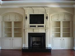 fireplace built in cabinets custom built shelves around tv round designs