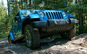 dark green jeep wrangler unlimited rocking out in the 2016 jeep wrangler