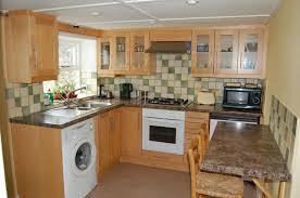 Washing Machine In Kitchen Design Kitchen With Granite Breakfast Table Combined Wooden