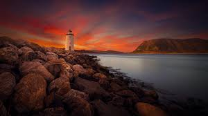 rocky shore wallpapers wallpaper lighthouse twilight sunset rocky shore 4k world 2261