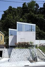 a l x junichi sampei elevates forest house in kanagawa