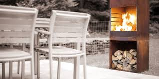 tole u0027s sleek outdoor fireplace also cooks pizza grills and more