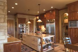 kitchen with stained alder wall cabinets and white painted island