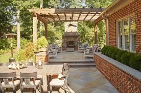 pergola patio with stone fireplace outdoor dining u2014 marcia fryer