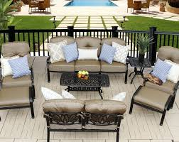 nassau cast aluminum powder coated 4 dining chairs with walnut seat