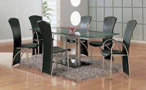 brown varnished mahogany legged glass dining table with fabric