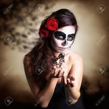 attractive young woman with sugar skull makeup stock photo