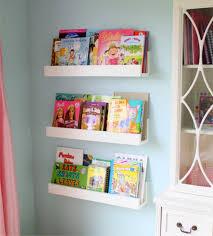 custom kid wall mounted bookshelf made of teak wood in white