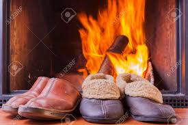 comfy rustic slippers at cozy warm fireplace in winter stock photo