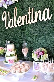 wedding backdrop name garden party with hedge wall background and gold name sign grass