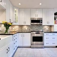 White Kitchen Cabinets And Black Countertops White Hanging Cabinet Finish Patterned Black Granite Countertop