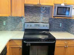 blue ceramic backsplash tile features a round overmount sink and
