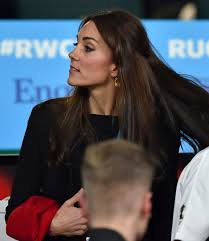 kate middleton wears her hair in half up hairstyle for a rugby