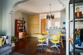 architect transforms turn of the century townhouse into a modern looking into the dining room kitchen from the living room the dining room has