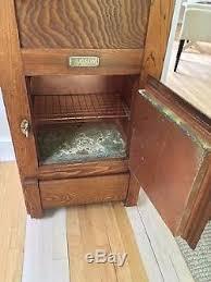 antique oak hudson ice box or liquor cabinet