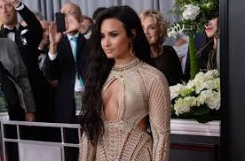 demi lovato carrie underwood wear flirty looks to grammys upi com