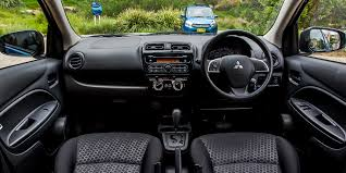 mitsubishi attrage 2016 interior suzuki celerio v mitsubishi mirage comparison review photos 1