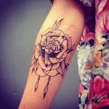 dotwork rose tattoo design for elbow
