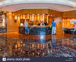 Restaurant Reception Desk by Receptionists And Guests At Reception Desk In Hotel Beach Resort