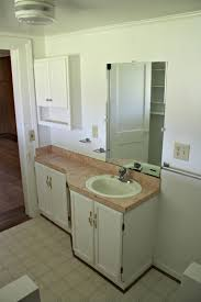 traditional bathroom with narrow bathroom vanities cabinet and
