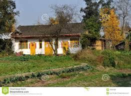 pengzhou china sichuan farmhouse with yellow doors and trim