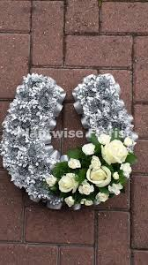 flowers for funerals horseshoe wreath made in flowers for funerals comes in two sizes