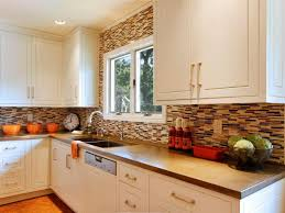 brown and white kitchen cabinets brown tile backsplash accents white cabinets hgtv