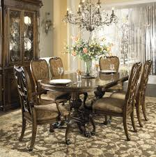formal dining table with two hand carved pedestals by fine dining table
