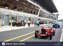 Old Classic Cars - old classic cars in the pit lane le mans classic france stock