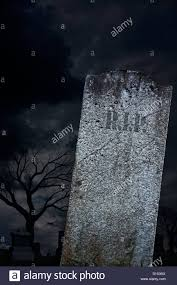 a scary graveyard with a blank grave stone ready for halloween