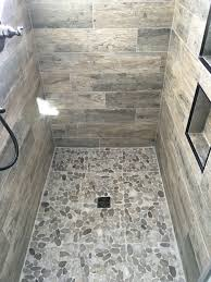 wood look tile shower with natural pebble floor superior