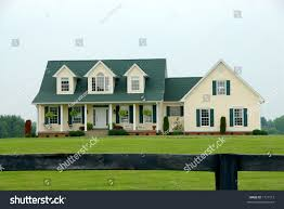 two story vinyl sided farmhouse sits stock photo 1717712