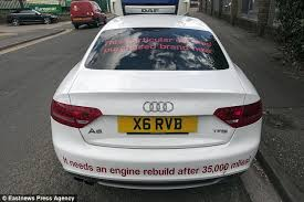 audi a5 engine problems motorist plasters his audi a5 with slogans and parks it outside