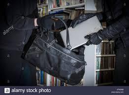 Burglars by Burglars Stealing Laptop Stock Photo Royalty Free Image