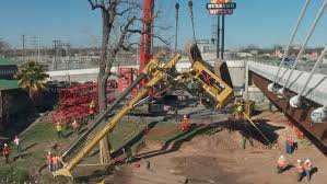 big crane pulls big machine free of brazos river muck