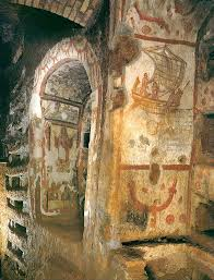 fresco decoration on two niches with loculi in the catacomb the catacombs of rome are ancient underground burial places under rome italy not the largest catacomb but the most interesting with an underground