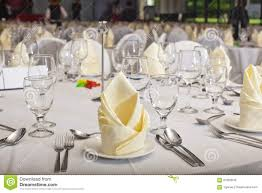 folded table napkin in formal table setting stock photo image