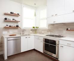 nice brown wooden kitchen cabinet as well as chrome microwave