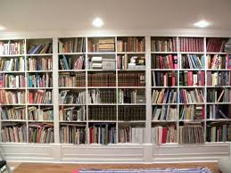 hand made painted living room cabinets and bookshelves by james