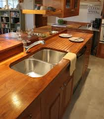 wooden countertops walnut wood countertop with drainboard face face grain teak countertop with undermount sink sloping drainboard and waterlox finish
