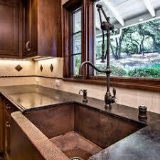Kitchen Sink Spanish - lake conroe spanish rustic kitchen austin by jauregui