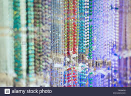 rosary store rosary bead selection in a religious goods store stock photo
