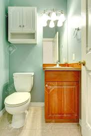 green mint fresh color small new bathroom with wood cabinet stock