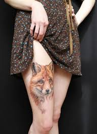 realistic fox tattoo on right upper leg